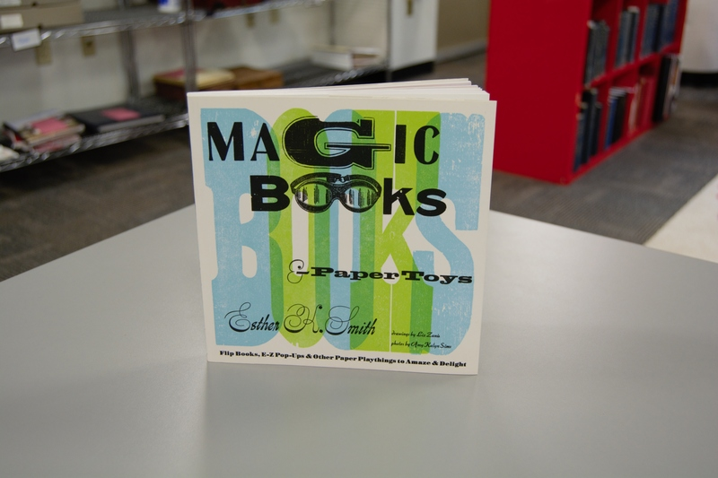 The front cover of Artist's Book Magic Books & Paper Toys: Flip Books, E-Z Pop-Ups & Other Paper Playthings to Amaze & Delight standing up